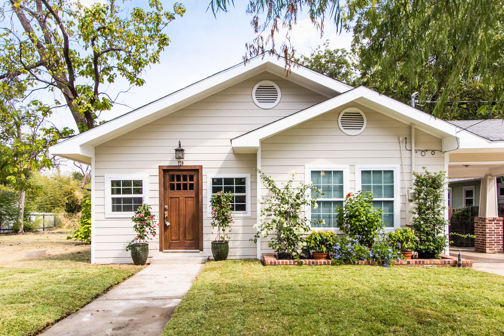 Inspiration for a timeless beige gable roof remodel in Dallas