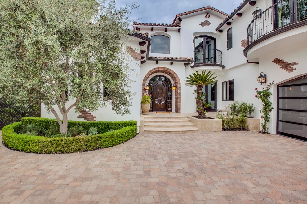 Mediterranean white two-story stucco exterior home idea in Los Angeles