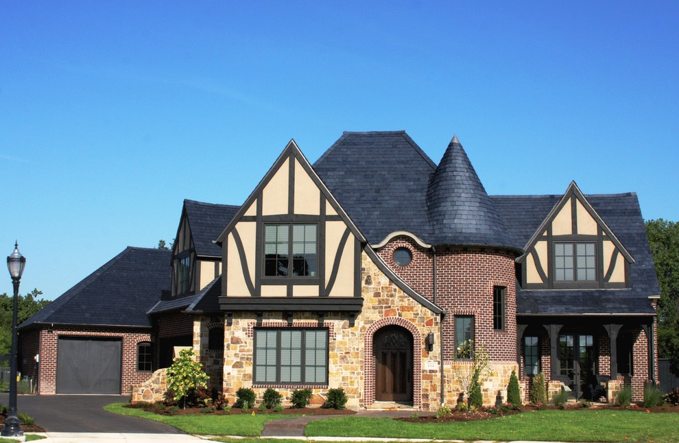Inspiration for a large timeless multicolored two-story mixed siding house exterior remodel in Dallas