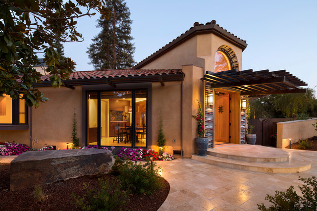 entry to modern hacienda home with jerusalem gold patio and walkways contemporary exterior