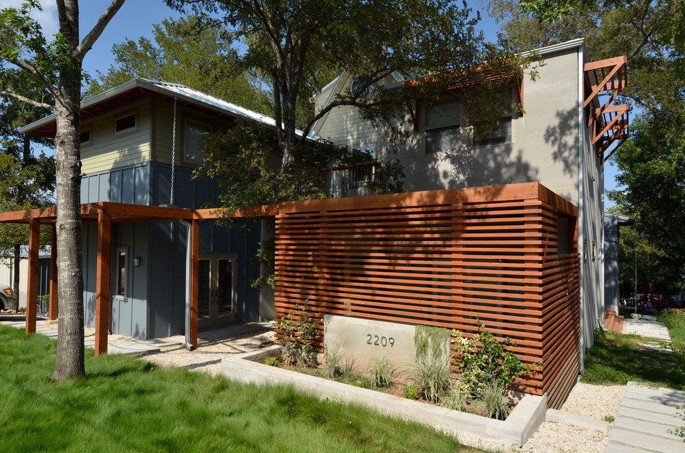 Trendy blue exterior home photo in Austin