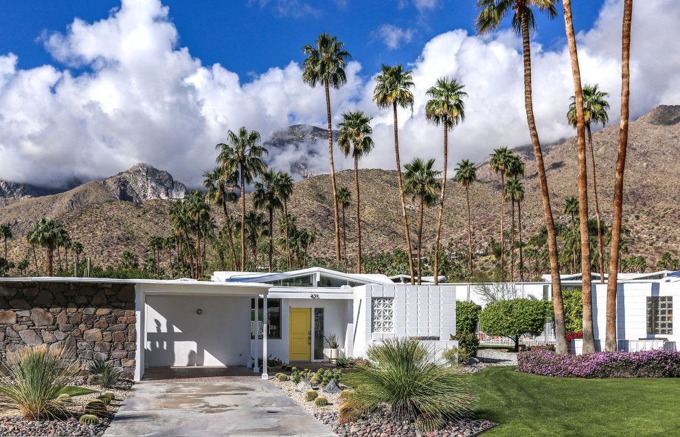 Inspiration for a large mid-century modern white one-story mixed siding exterior home remodel in Other