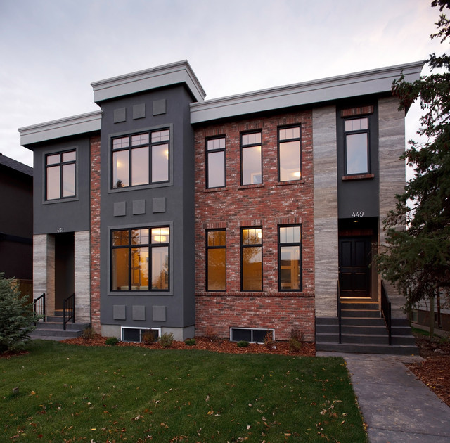 Inspiration for a contemporary two floor brick semi-detached house in Calgary.