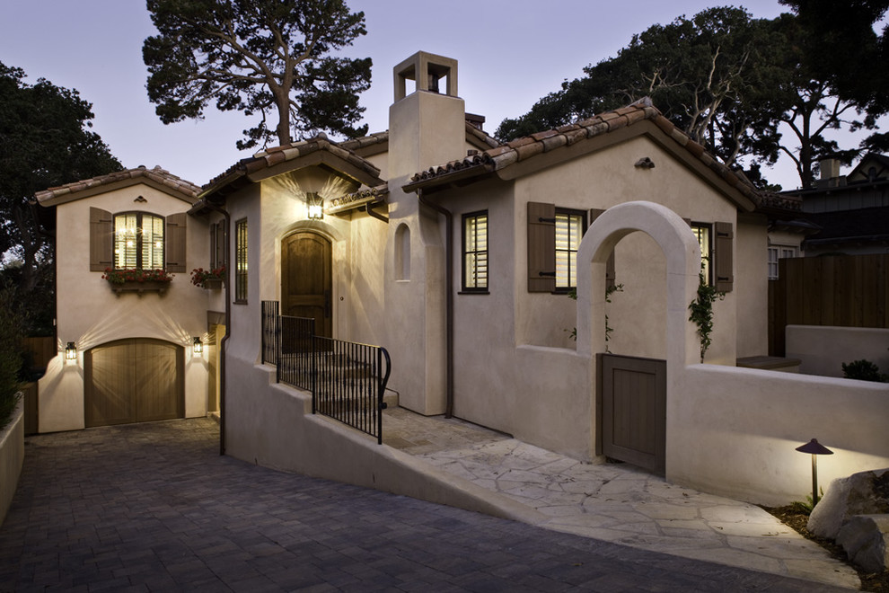 Example of a mid-sized tuscan exterior home design in Other