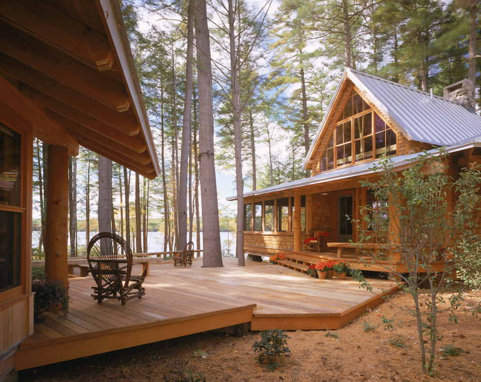 Rustic one-story wood exterior home idea in Portland Maine