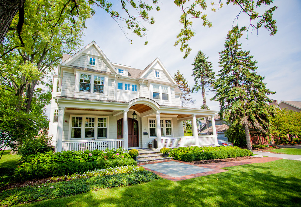 Example of a classic wood exterior home design in Chicago