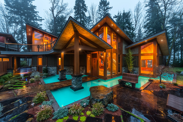 Inspiration for a large rustic two-story mixed siding exterior home remodel in Vancouver with a shed roof