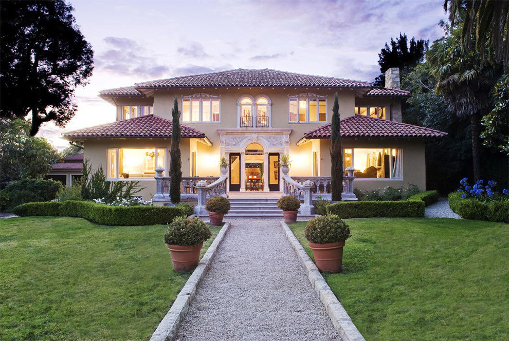 Tuscan two-story stucco exterior home photo in Santa Barbara