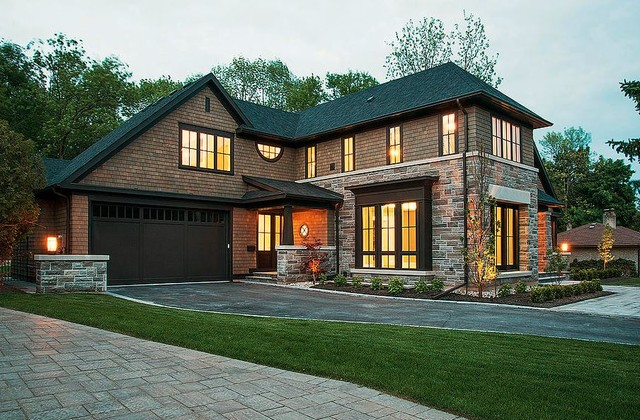 Inspiration for a large craftsman brown two-story stone exterior home remodel in Toronto