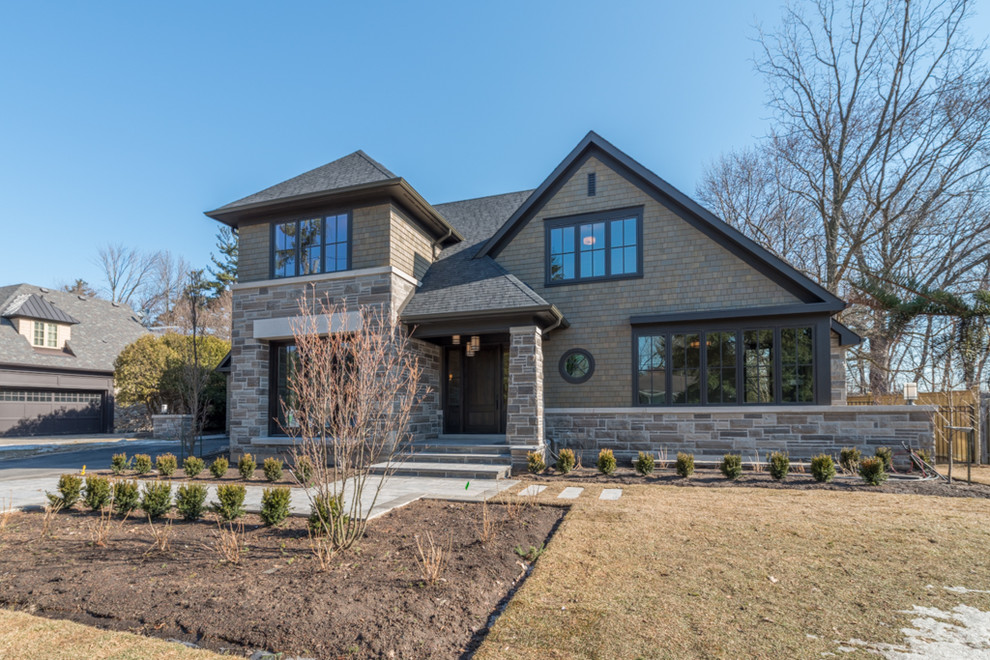 Inspiration for a large brown two-story stone exterior home remodel in Toronto
