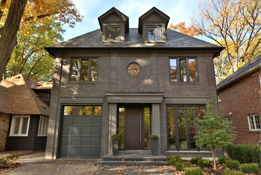 Large trendy brown two-story brick exterior home photo in Toronto with a hip roof