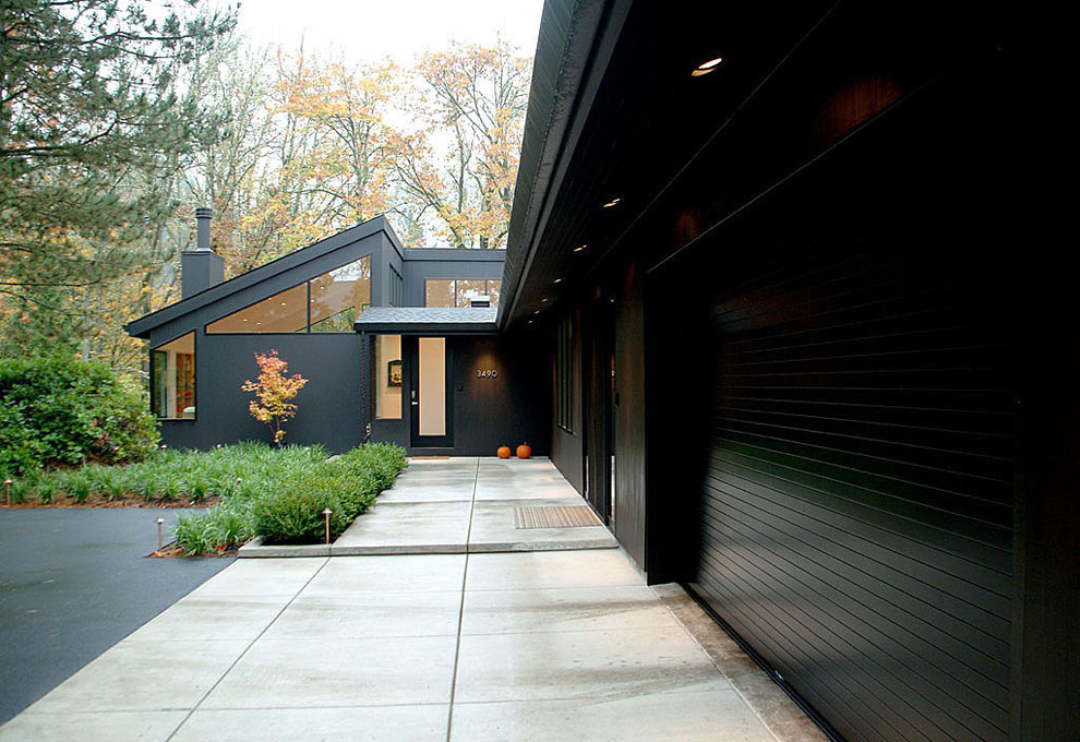 Example of a trendy one-story exterior home design in Portland