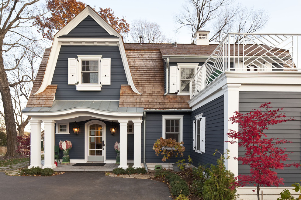 Example of a classic gray two-story exterior home design in Minneapolis