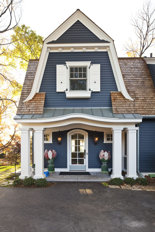 Inspiration for a timeless exterior home remodel in Minneapolis with a gambrel roof