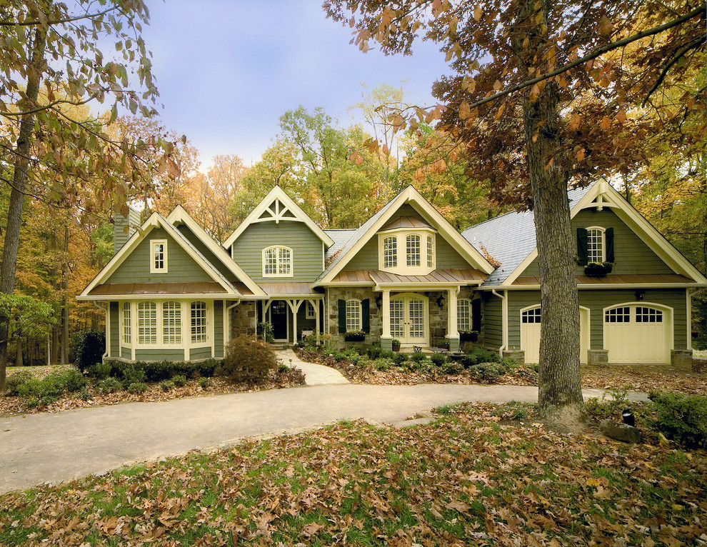 Inspiration for a large timeless green two-story wood exterior home remodel in DC Metro with a shingle roof