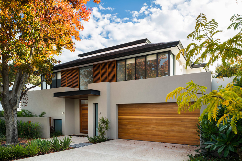 Large contemporary gray two-story concrete exterior home idea in Perth