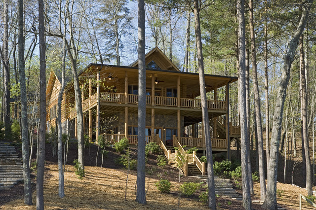Exterior of a rustic round log and timber home traditional exterior