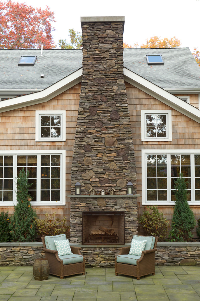 Inspiration for a large timeless brown two-story wood exterior home remodel in Salt Lake City with a shingle roof