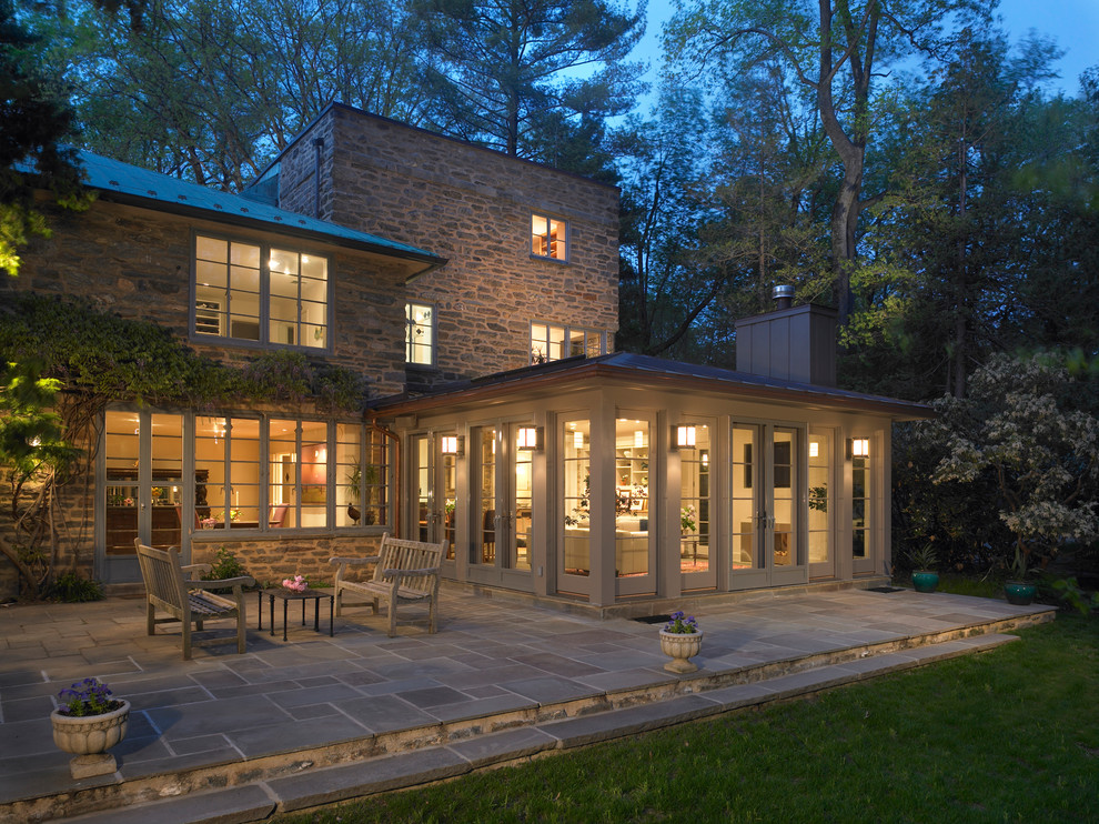 Example of a mid-sized classic gray stone exterior home design in Philadelphia
