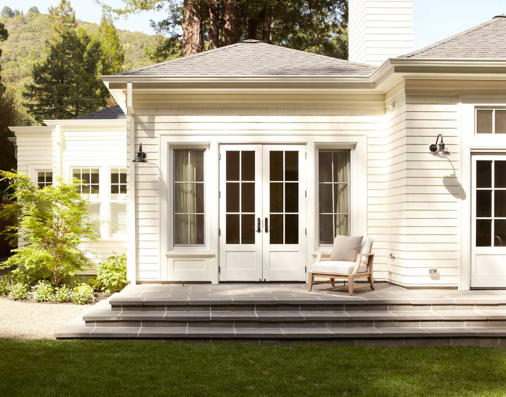 Exterior porch landing and steps of bluestone