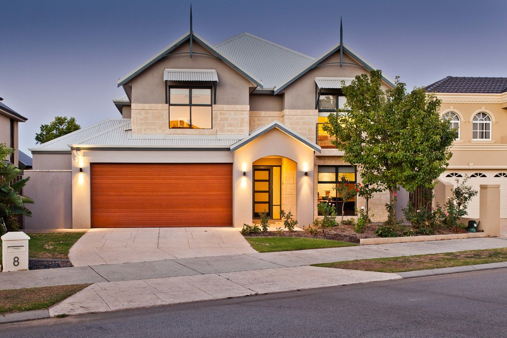 Example of a trendy stucco exterior home design in Perth