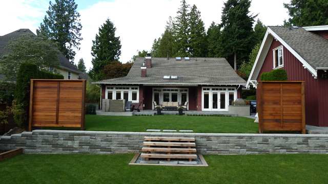 Example of a mid-sized arts and crafts red wood exterior home design in Vancouver with a gambrel roof