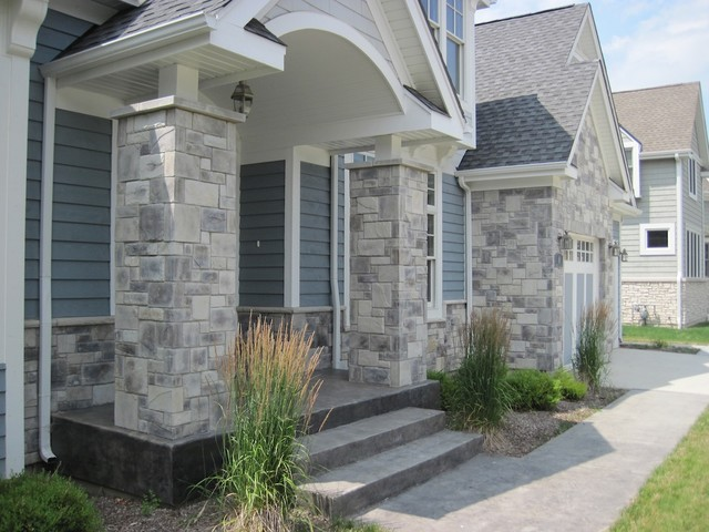 Exterior Stone Siding and Hardie Board traditional-exterior