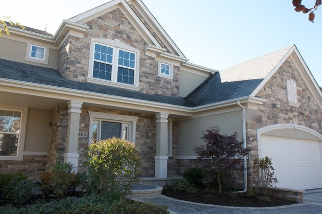 Exterior stone siding with stucco traditional exterior for Stucco and siding combinations