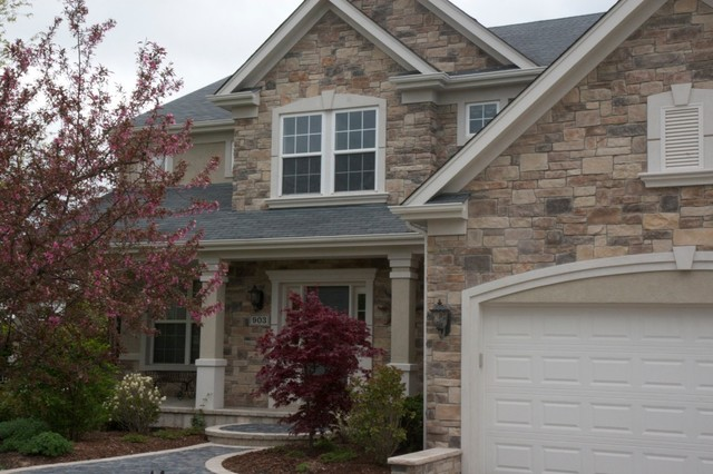 Exterior stone siding with stucco traditional exterior for Stucco stone exterior designs