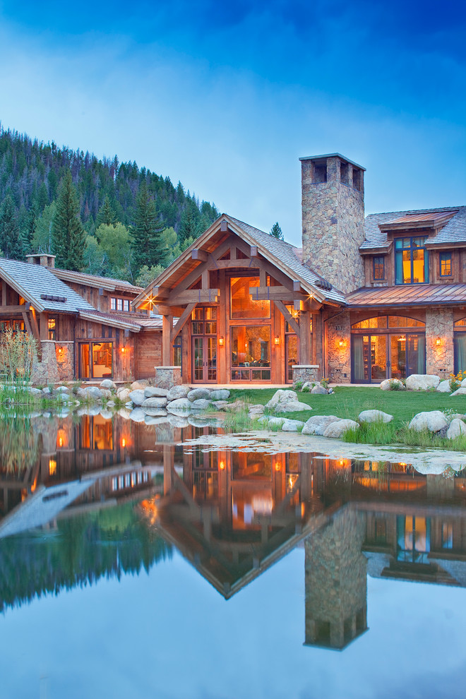 Inspiration for a rustic two-story exterior home remodel in Denver