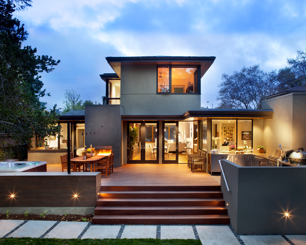 Mid-sized contemporary gray two-story stucco exterior home idea in San Francisco with a hip roof and a shingle roof