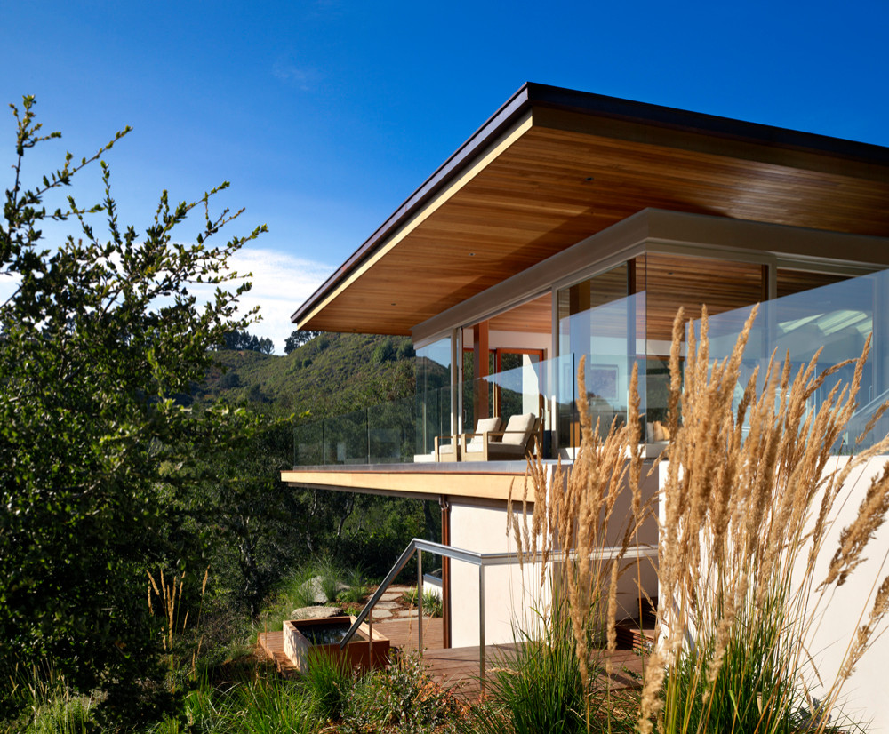 Exterior with glass walls and cedar ceiling