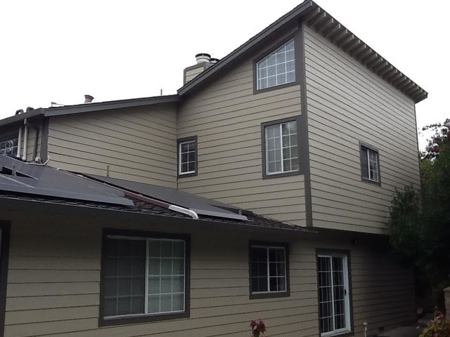 Example of a classic beige wood gable roof design in Sacramento