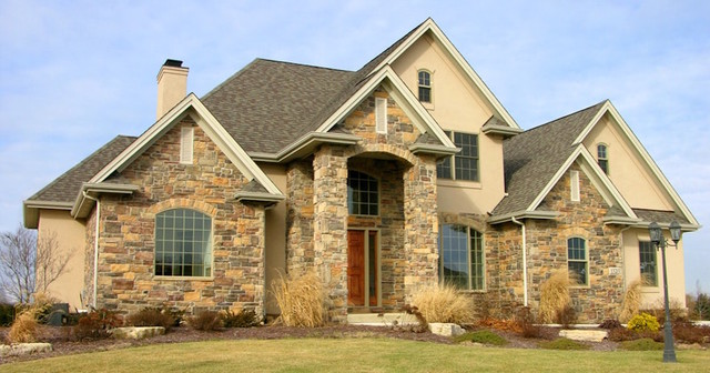 Mid-sized craftsman brown one-story stone exterior home idea in Chicago with a shingle roof