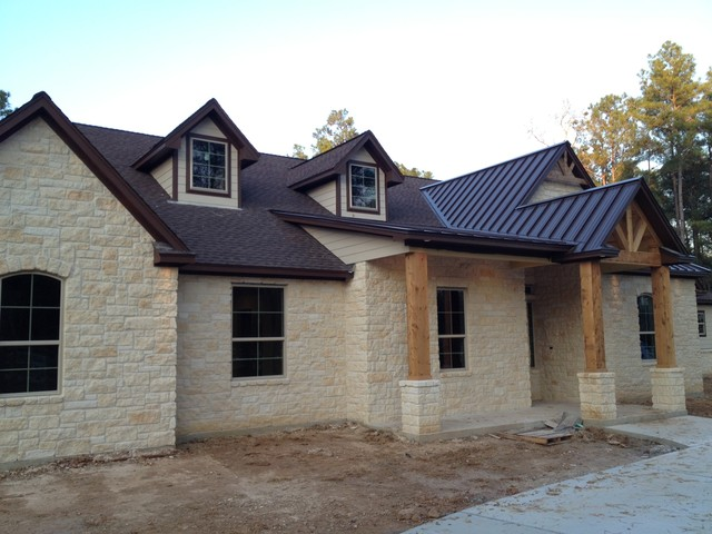 Exteriors traditional exterior houston by kurk homes for Metal roof ranch house