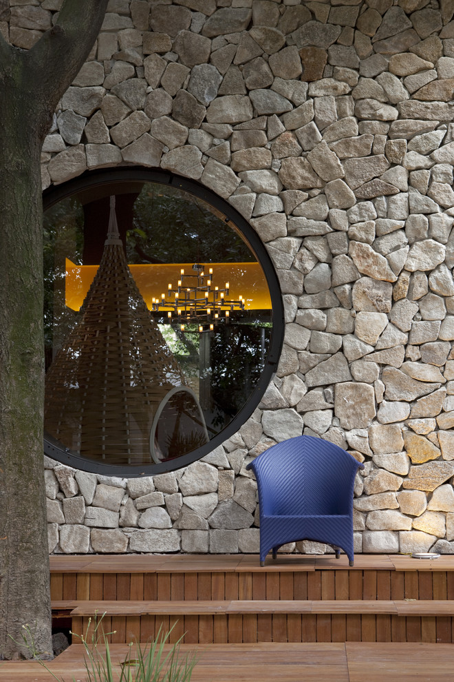 Inspiration for a modern stone exterior home remodel