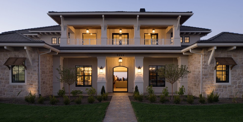 Huge transitional beige two-story mixed siding house exterior photo in Boise with a hip roof and a tile roof