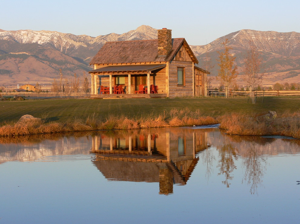 Inspiration for a rustic wood exterior home remodel in Phoenix