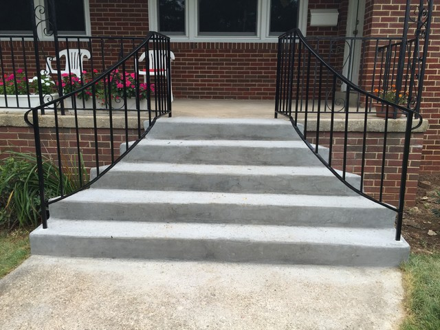 Fanned Out Concrete Stairs With Curved Iron Railing Traditional Exterior