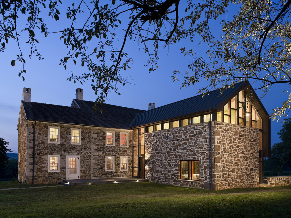 Trendy brown two-story stone gable roof photo in Philadelphia