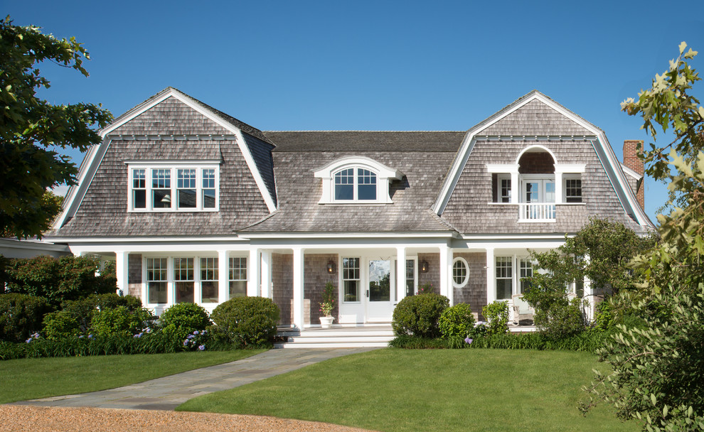 Inspiration for a coastal two-story wood exterior home remodel in DC Metro with a gambrel roof