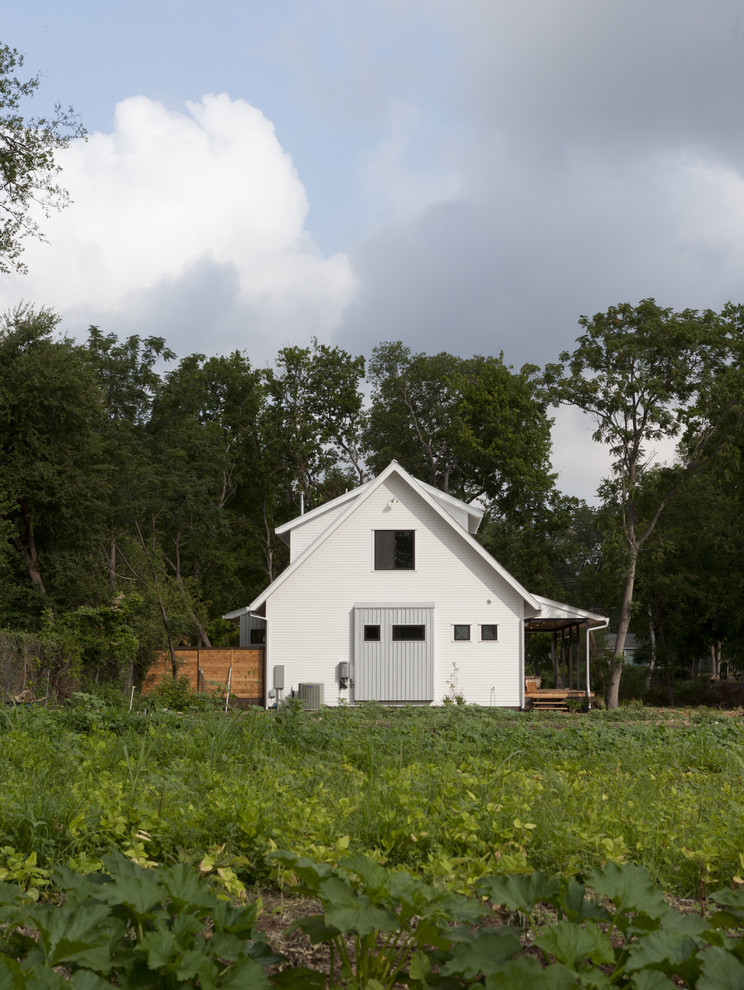 Farmhouse two-story gable roof idea in Austin