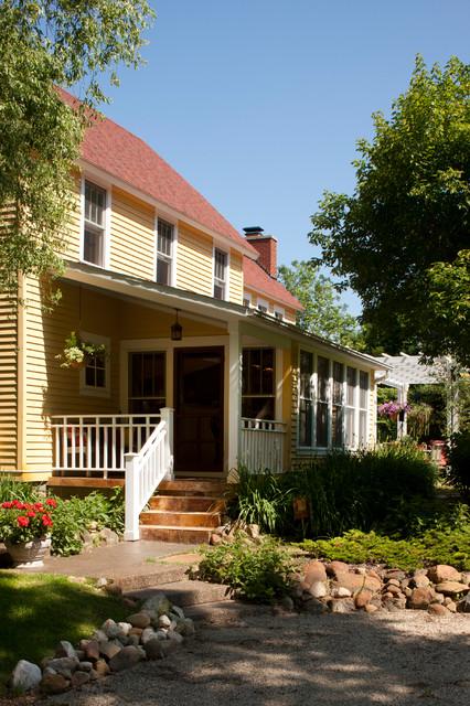 Farmhouse exterior home photo in Grand Rapids