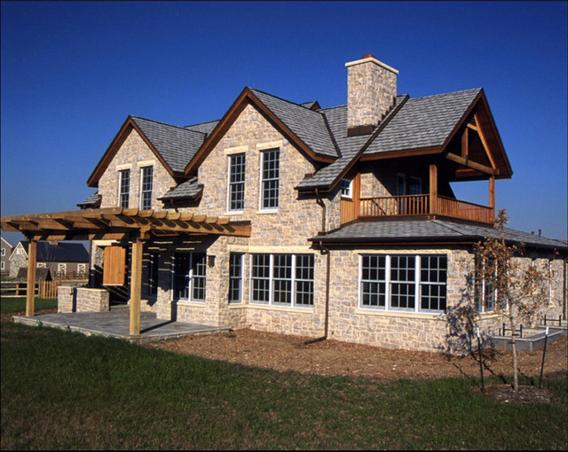 Farmhouse style new construction traditional exterior for Farm house construction
