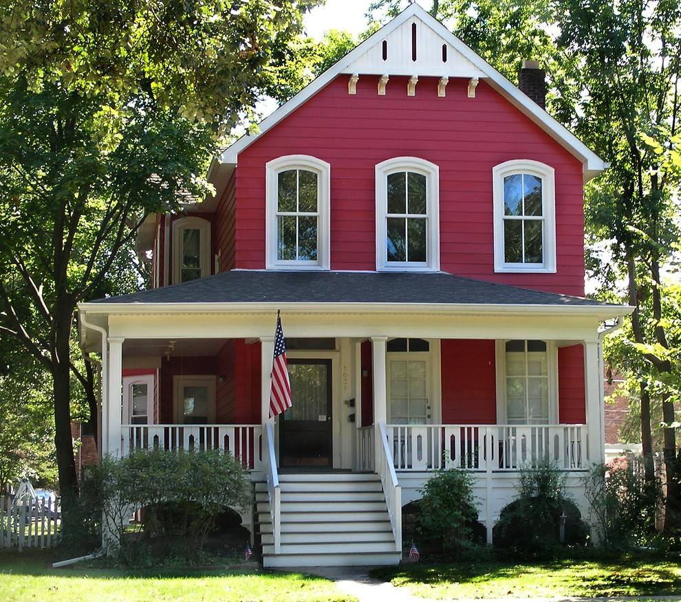 Mid-sized victorian red two-story exterior home idea in Chicago