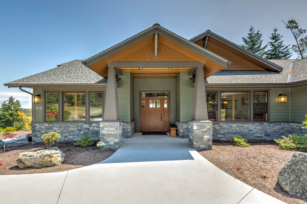 Mid-sized arts and crafts green one-story concrete fiberboard exterior home photo in Seattle with a shingle roof