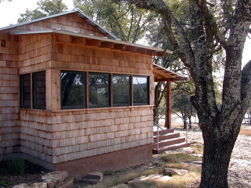 Rustic exterior home idea in Austin