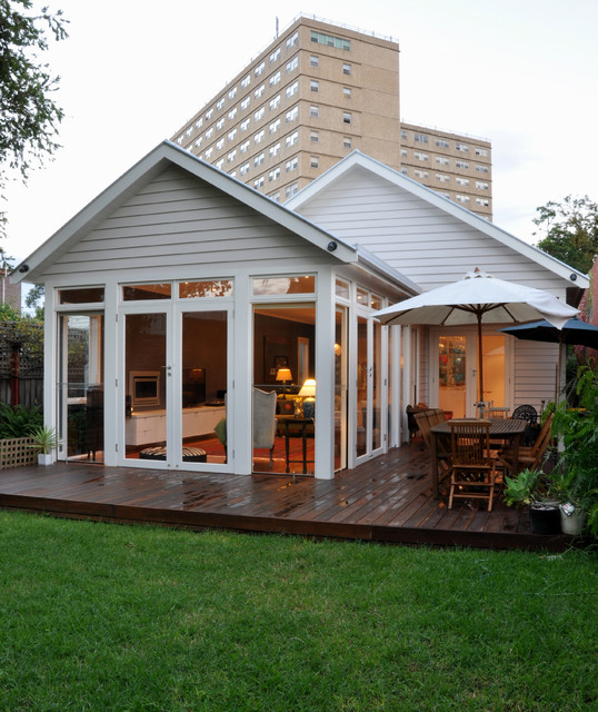 Example of a mid-sized minimalist white wood exterior home design in Geelong with a metal roof