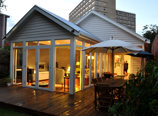 Inspiration for a mid-sized modern white wood gable roof remodel in Geelong with a metal roof