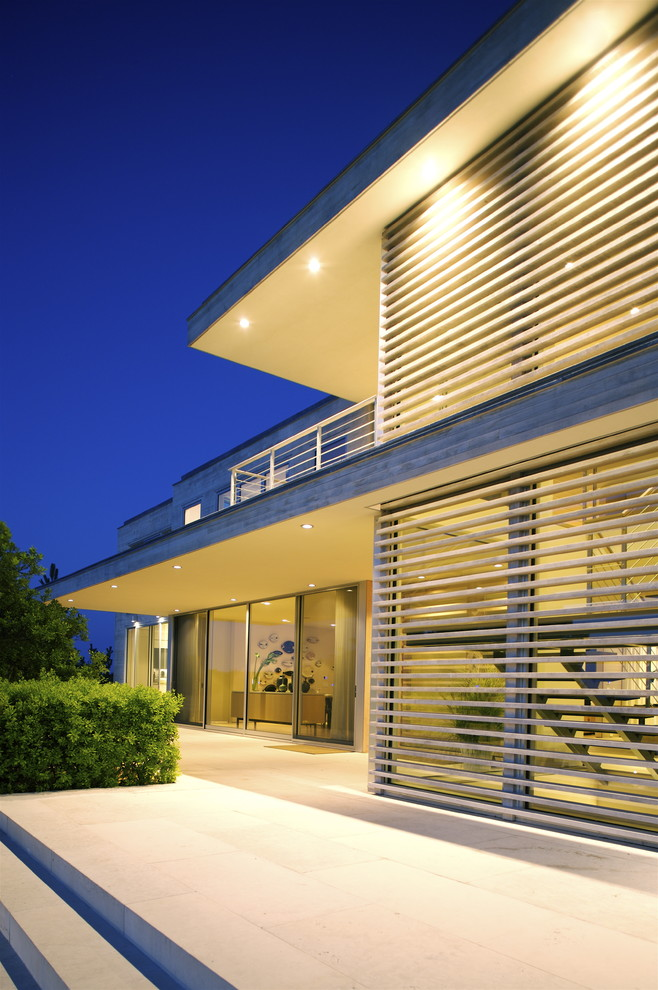Example of a minimalist glass exterior home design in New York